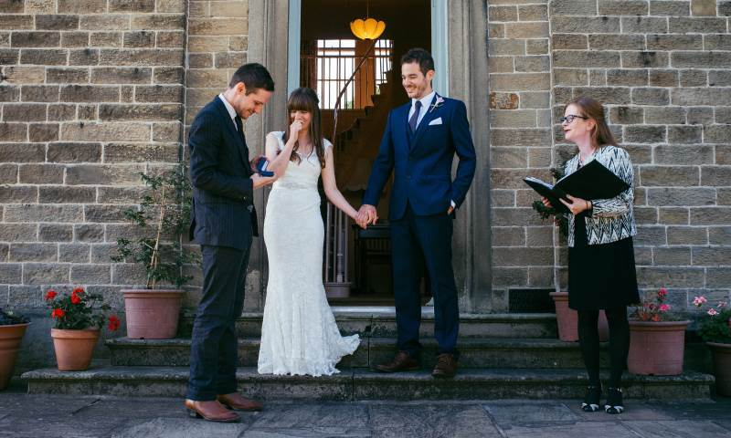 Couple getting married on steps of Newton Grange