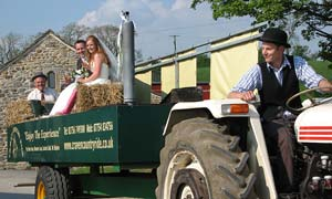 tractor arriving with groom and bride